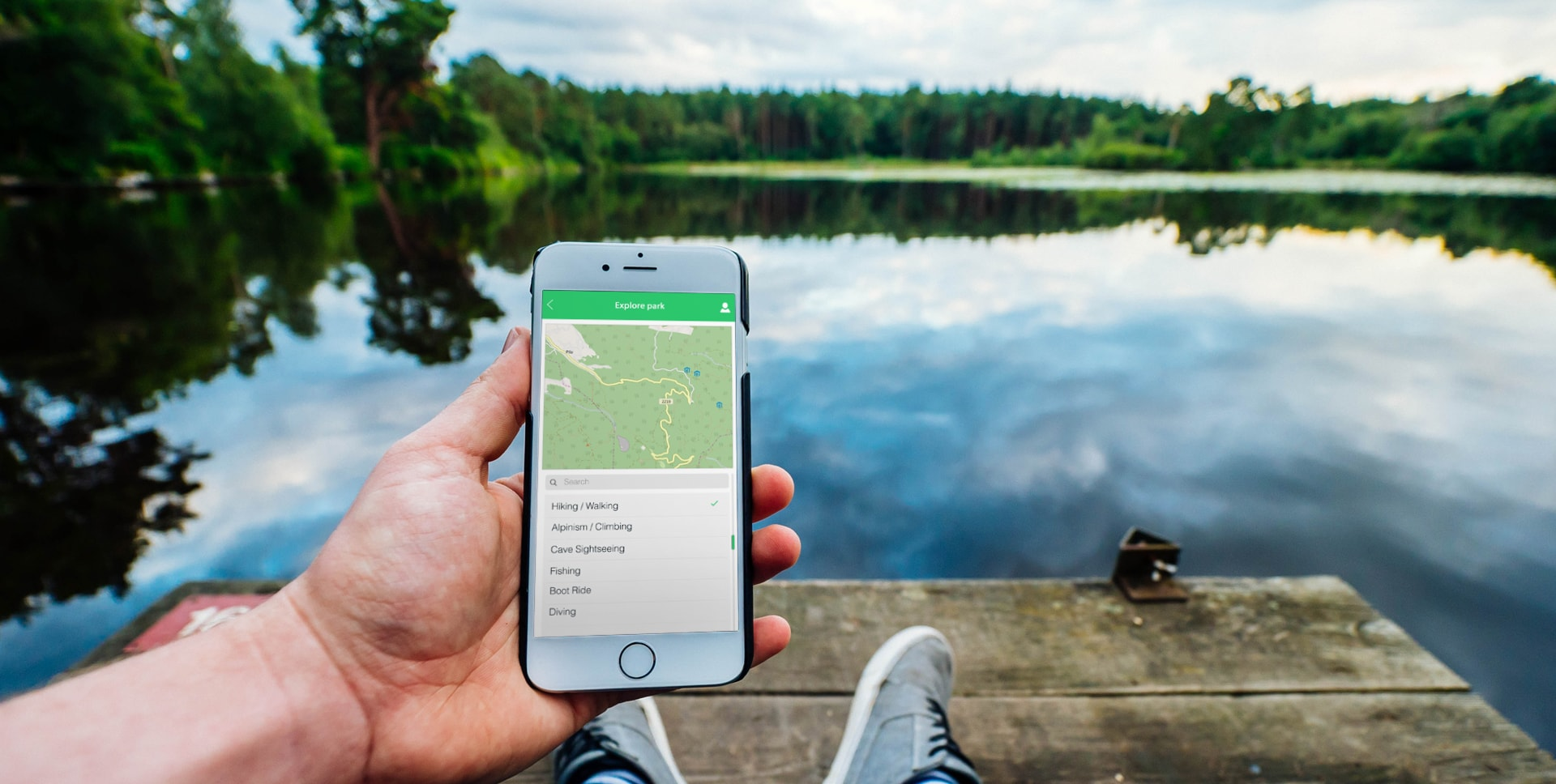 Banner image of a lake in a croatian park. parks of croatia     app is shown on a phonescreen