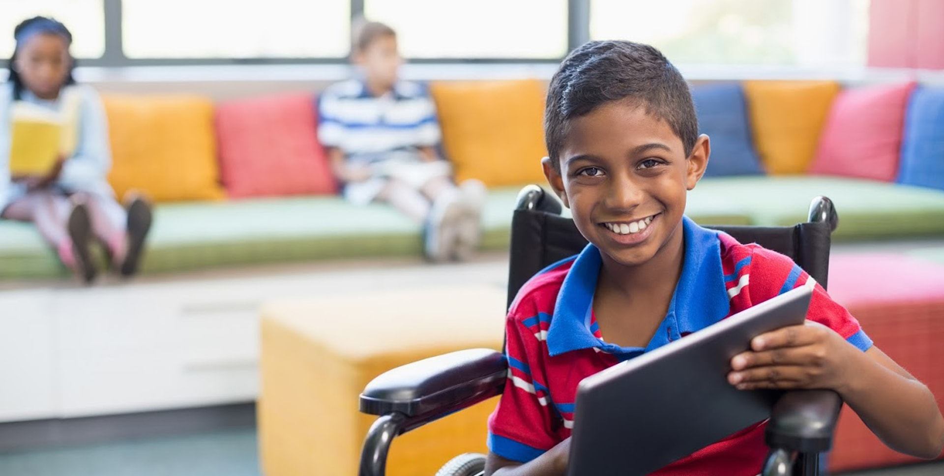 Banner image showing an Indian boy in a wheelchair holding an iPad